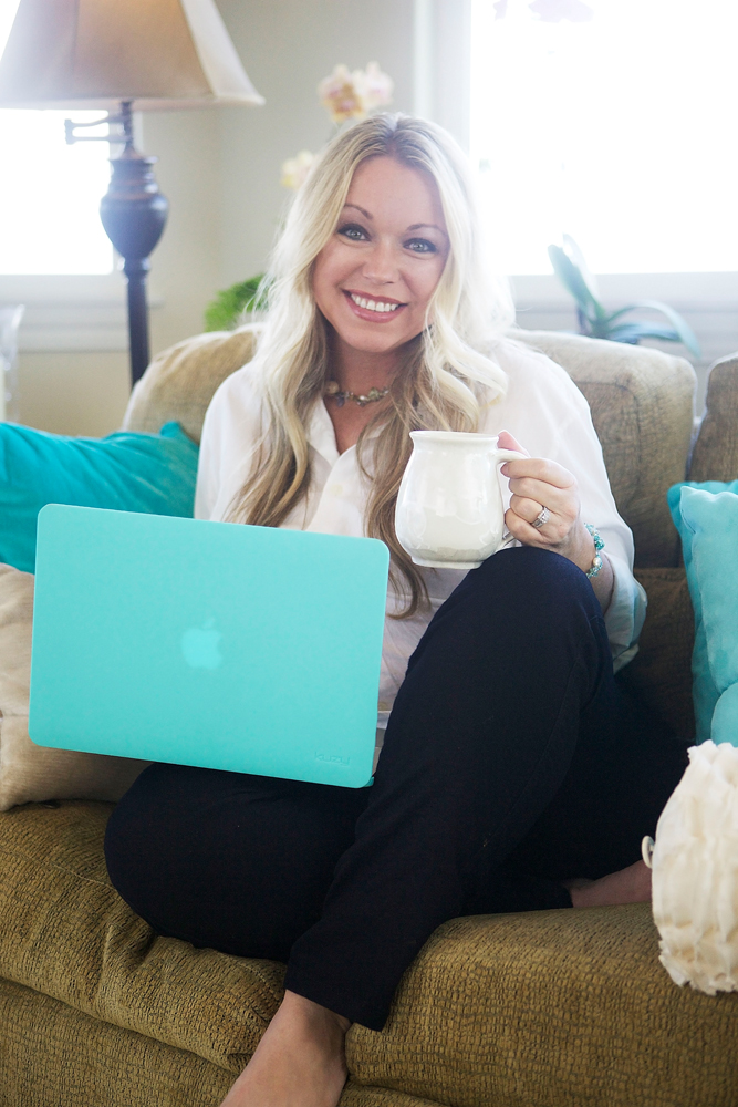 Athena Moberg sitting on the couch, in the living room, drinking coffee, working on the computer, Maui, Hawaii, circa 2014